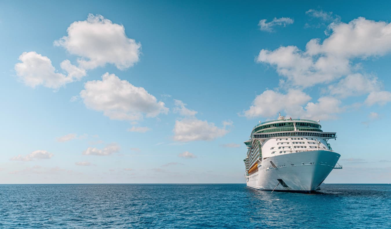 A large cruise ship anchored in the calms waters of the Cayman Islands