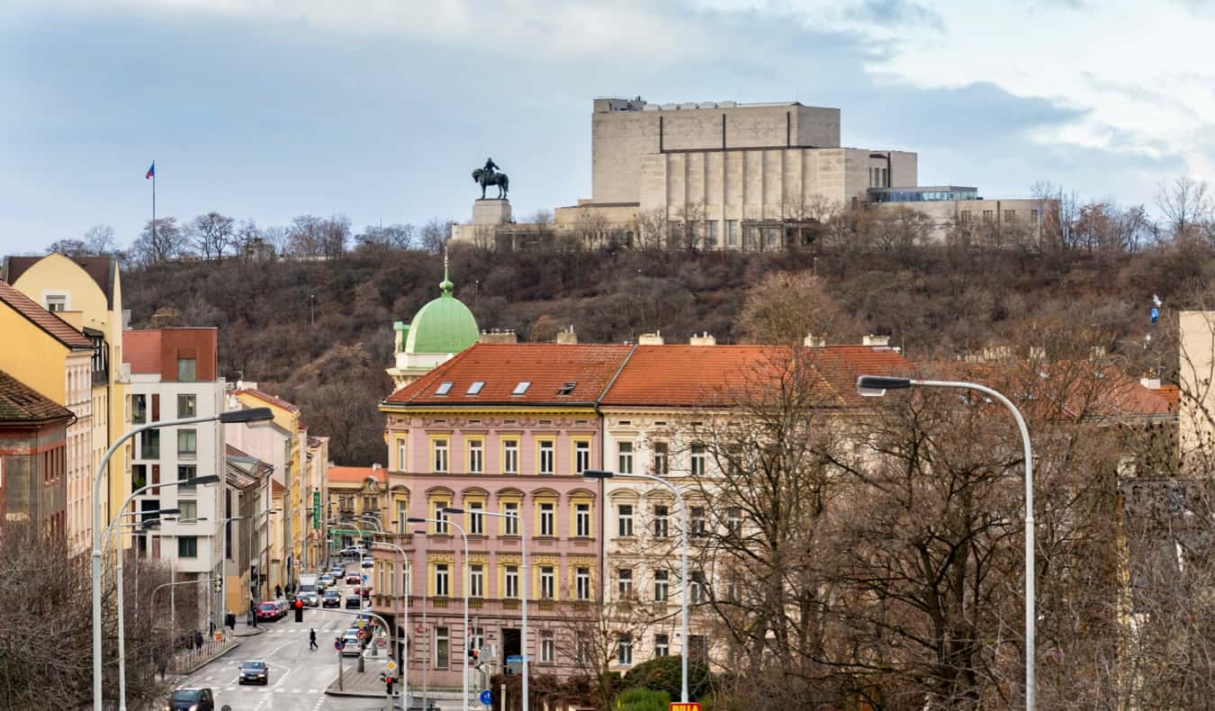 A statue in the distance looking out over the Karlin neighborhood in Prague, Czechia