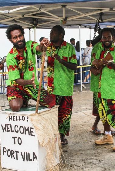 Locals welcoming people with music in Port Vila, Vanuatu